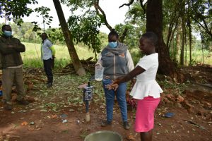 The Water Project:  Community Member Tries Out The Ten Handwashing Steps