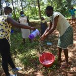 The Water Project: Kimang'eti Community, Kimang'eti Spring -  Helping A Community Member Wash Her Hands