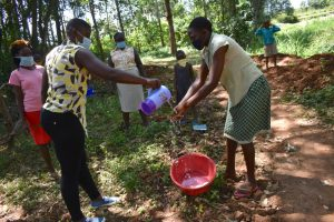 The Water Project:  Helping A Community Member Wash Her Hands