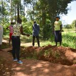 The Water Project: Kimang'eti Community, Kimang'eti Spring -  Discussing Cut Off Drainage Maintainance
