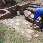 The Water Project: Mahira Community, Mukalama Spring -  Rub Wall Construction