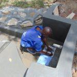 The Water Project: Mahira Community, Mukalama Spring -  Tile Setting