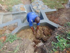 The Water Project:  Backfilling With Clay