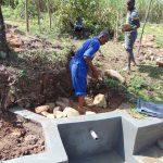 The Water Project: Mahira Community, Mukalama Spring -  Backfilling With Large Rocks