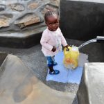 The Water Project: Mahira Community, Mukalama Spring -  Child Accessing Water Easily