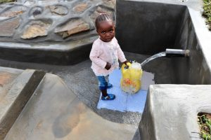 The Water Project:  Child Accessing Water Easily