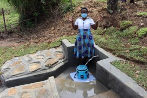 The Water Project:  Field Officer Betty Celebrates The Completed Spring