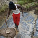 The Water Project: Mukhungula Community, Mulongo Spring -  Laying Sping Foundation