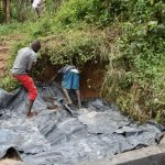 The Water Project: Mukhungula Community, Mulongo Spring -  Backfilling With Tarp