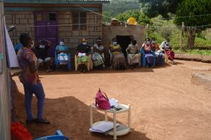 The Water Project:  Participants Stay Cool In The Shade