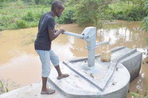 The Water Project:  Using The New Well