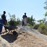The Water Project: Yumbani Community A -  Mixing Cement And Sand