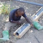 The Water Project: Yumbani Community A -  Working On Infiltration Pipes