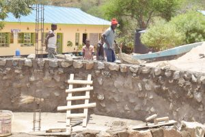 The Water Project:  Adding Stone To Tank Walls