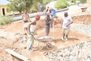 The Water Project:  Dumping Rocks For Foundation