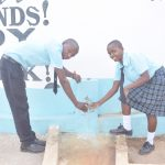 The Water Project: Mutwaathi Secondary School -  Filling Up Glasses With Water