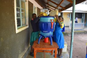 The Water Project:  Adding Water To Filter For Storage