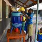 The Water Project: Ibokolo Primary School -  Many Jerrycans To Fill One Filter