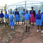 The Water Project: Ibokolo Primary School -  Students And Teacher At School Gate