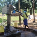 The Water Project: Emachina Primary School -  Britton Fetching Water For School