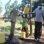 The Water Project: Emachina Primary School -  Mr Shikwati Fetching Water For School