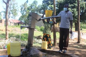 The Water Project:  Mr Shikwati Fetching Water For School