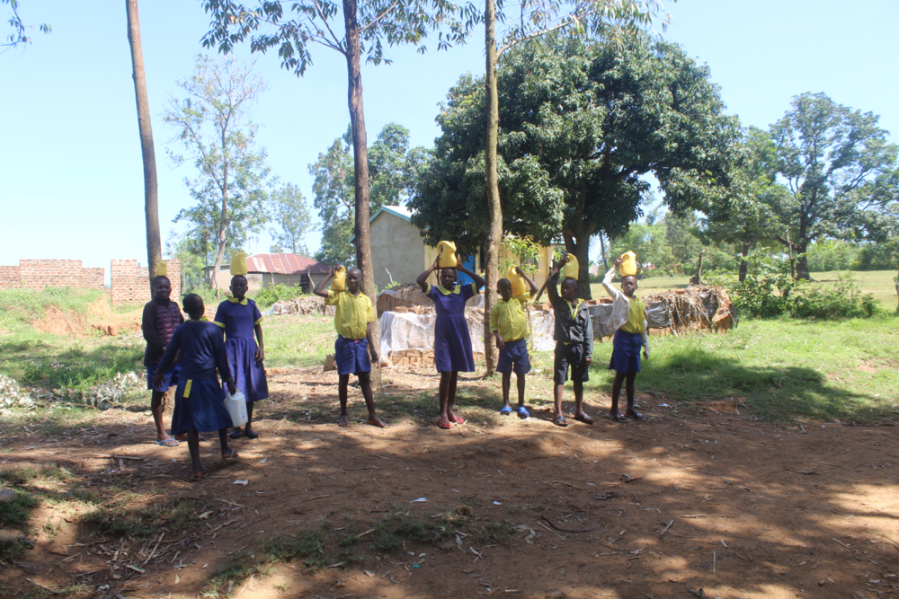 The Water Project : kenya21353-students-carrying-water-2