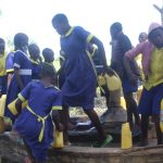 The Water Project: Emachina Primary School -  Students Fetching Water