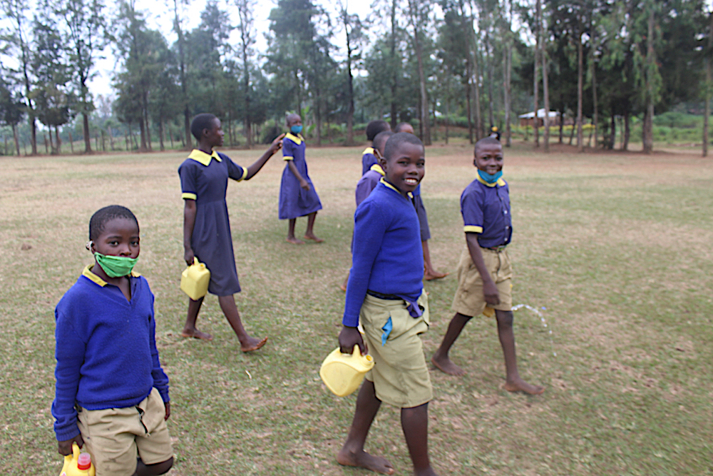 The Water Project : kenya21354-students-carrying-water-3