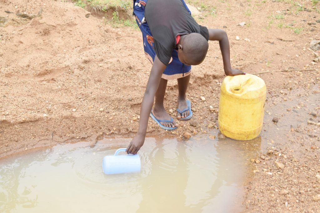The Water Project : kenya21422-21423-collecting-water