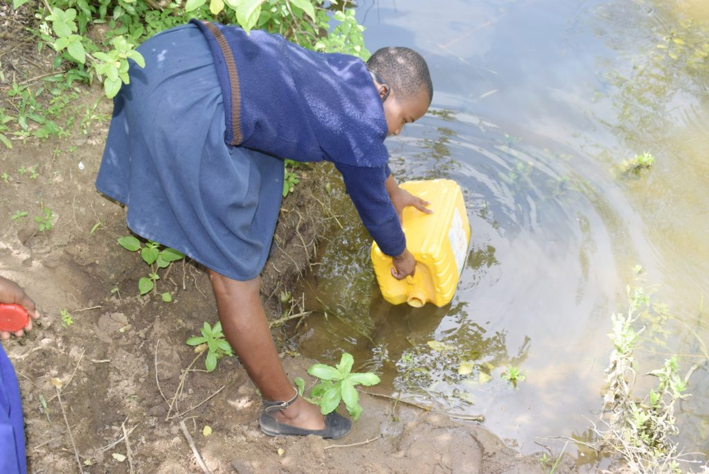 The Water Project : kenya21461-students-collecting-water-3