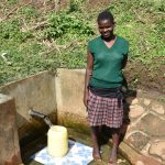The Water Project: Ataku Community, Ngache Spring -  Irene Fetches Water
