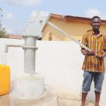 The Water Project: Sulaiman Memorial Academy Jr. Secondary School -  Community Member Joyfully Collecting Water