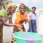 The Water Project: Sulaiman Memorial Academy Jr. Secondary School -  Community Members Joyfullly Splashing Water