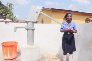 The Water Project:  Student Joyfully Collecting Water