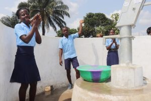 The Water Project:  Students And Community Members Celebrating