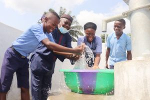 The Water Project:  Students And School Supervisor Splashing Water