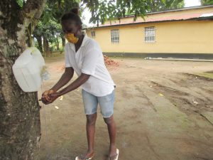 The Water Project:  Participant Demonstrating Handwashing With Tippy Tap