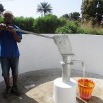 The Water Project: Lungi, Suctarr, #3 Lovell Lane -  Staff Collecting Water After Installation