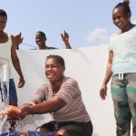 The Water Project: Lungi, Suctarr, #3 Lovell Lane -  Woman Happily Looking At Clean Water Flowing On Her Hands