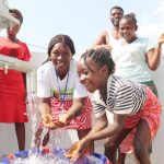 The Water Project: Lungi, Suctarr, #3 Lovell Lane -  Councilor Fatmata Akai And Girl Splashing Water