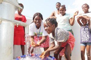 The Water Project:  Councilor Fatmata Akai And Girl Splashing Water