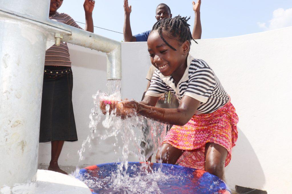 The Water Project : sierraleone20412-kid-joyfully-looking-at-clean-water-flowing-in-her-hands