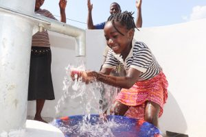The Water Project:  Kid Joyfully Looking At Clean Water Flowing In Her Hands