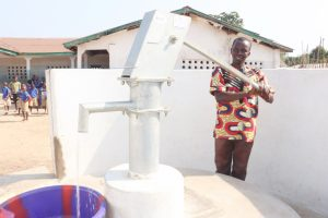 The Water Project:  Head Teacher Joyfully Collecting Water