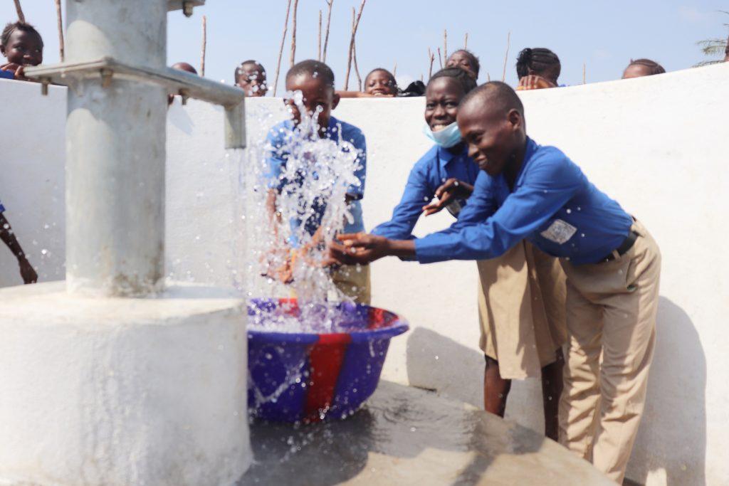 The Water Project : sierraleone20413-students-joyfully-celebrating-and-splashing-water-3