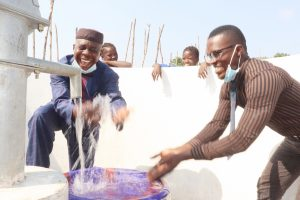 The Water Project:  Supervisor Od Schools And Mapping Officer Ministry Of Water Resources Splashing Water
