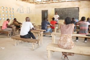 The Water Project:  Hygiene Facilitator Teaching About Bad Hygiene Pratice
