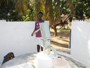 The Water Project:  Community Member Collecting Water After Installation