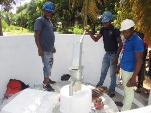The Water Project:  Staff Collecting Water After Installation
